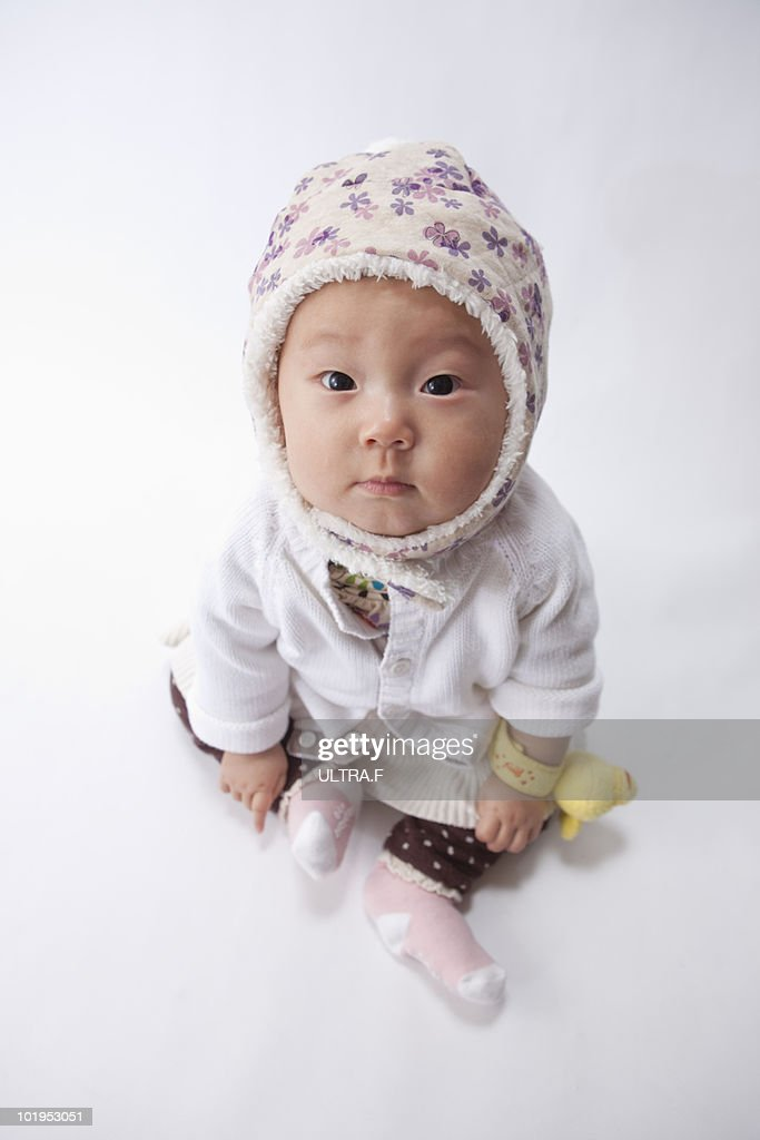 Baby wearing a knitted hat : Stock Photo