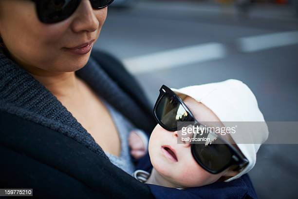 Baby wearing adult sunglasses