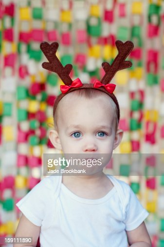 Baby wearing antlers : Stock Photo
