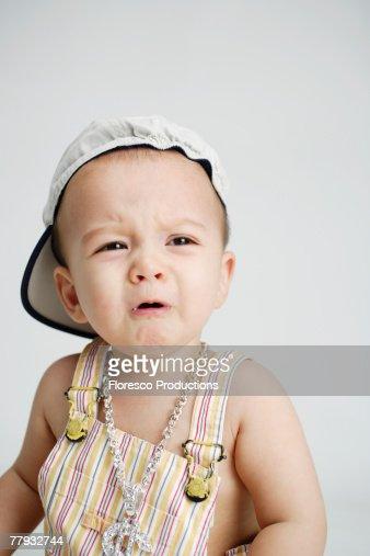 Baby wearing large money sign necklace : Photo
