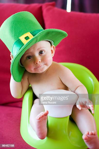 Baby wearing leprechaun hat