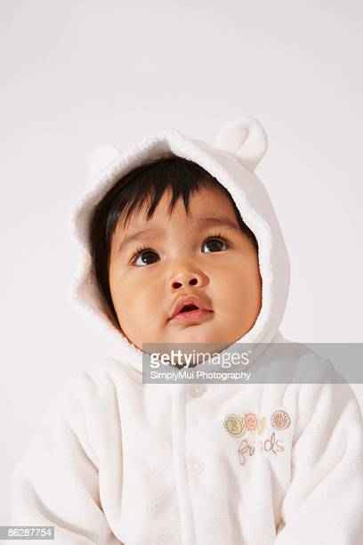 Baby wearing outfit with ears on hood