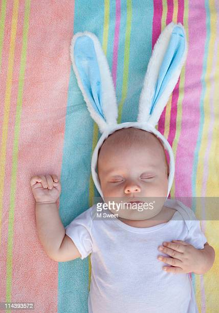 Baby wearing rabbit ears