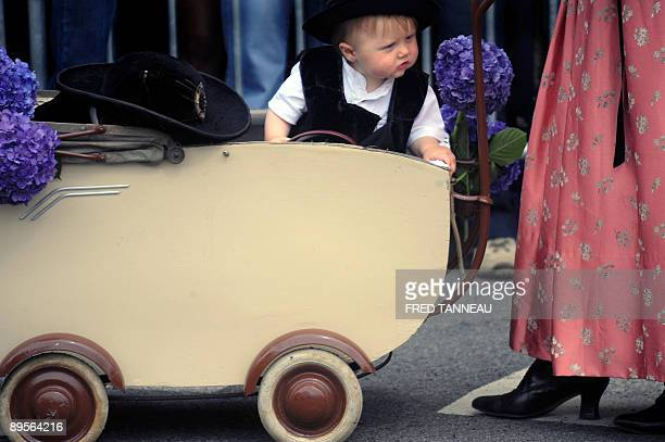 A baby wearing traditionnal clothes is seen on August 2 2009 in Lorient western France during the celtics nations Great Parade of the 'festival...
