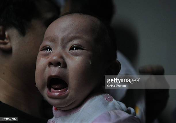 A baby who drank tainted milk powders receives typeB ultrasonic examination in a Hospital on September 17 2008 in Wuhan of Hubei Province China...