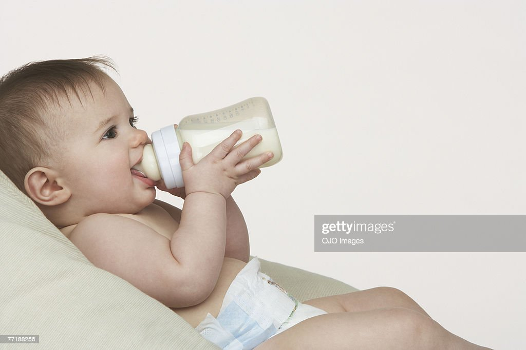 A baby with a bottle : Stock Photo
