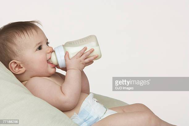 A baby with a bottle
