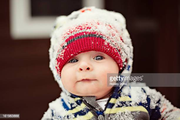 Baby With Blue Eyes Wearing A Hat