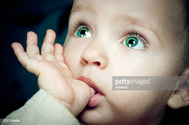 Baby with finger in her mouth