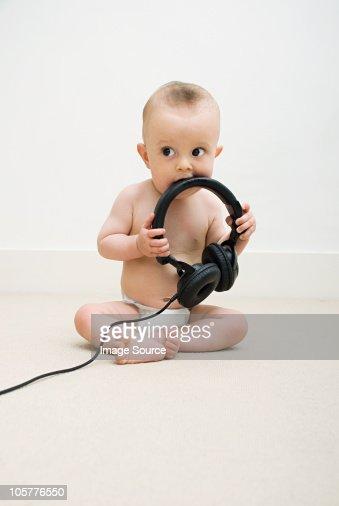 Baby with head phones : Stock Photo
