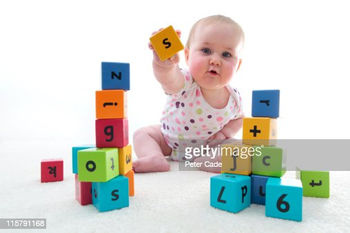 baby with learning bricks : Stock Photo