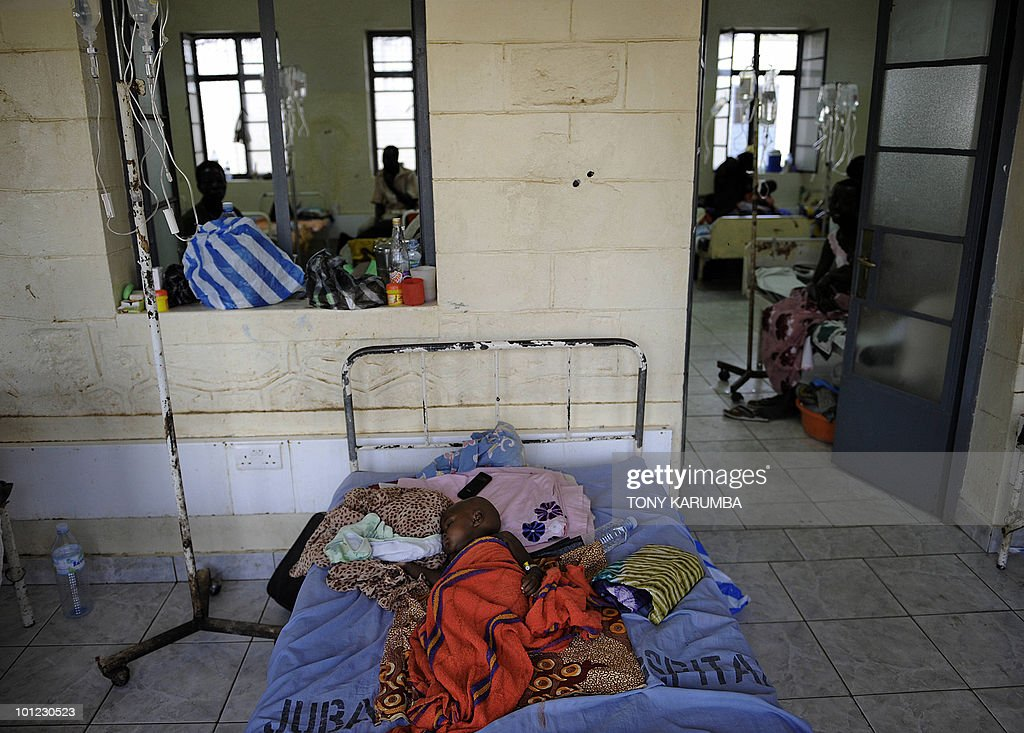 A baby with malaria lays in bed in a malaria ward on April 2, 2009 in the main hospital in Juba, where the population is exposed to malaria, a vector-borne, infectious parasitic disease that is a leading cause of death of infants and children in Africa. Some 4-10 billion US dollars is still needed to ensure the achievement of the universal coverage of more than 6 million people by 2010 according to the Global Fund to Fight AIDS, Tuberculosis and Malaria who sponsor ongoing intervention programmes in south Sudan. UN Secretary General Ban Ki-moon said on March 31, in a video message played at the start of a two-day meeting in Spain of key donors to the Global Fund that malaria cost Africa 12 billion dollars a year, but just 3.4 billion dollars is needed annually for prevention and treatment. AFP PHOTO / Tony KARUMBA