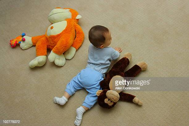 baby with monkeys on the floor