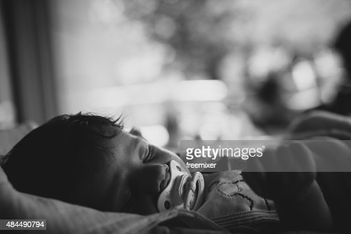 Baby with pacifier slepping