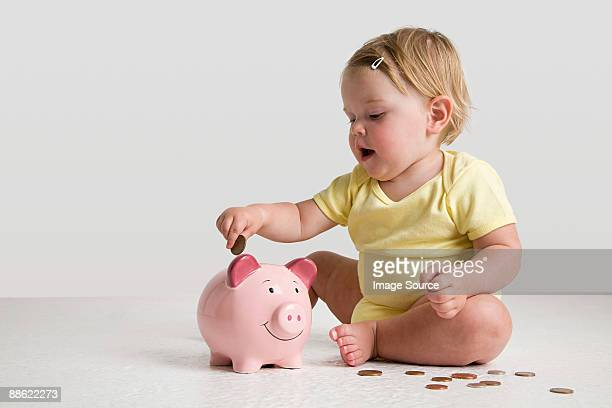 Baby with piggy bank