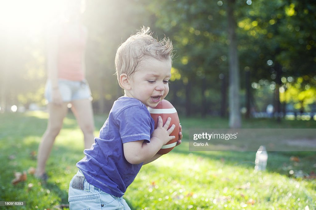 Baby with rugby ball