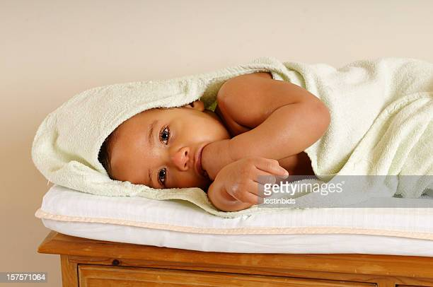 Baby Wrapped In A Towel Relaxing During Bathtime