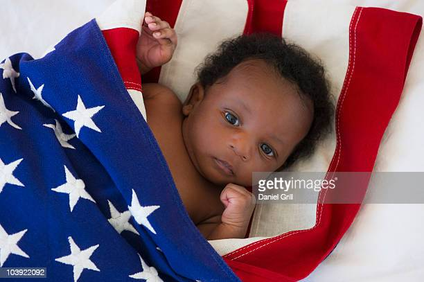 Baby wrapped in American flag