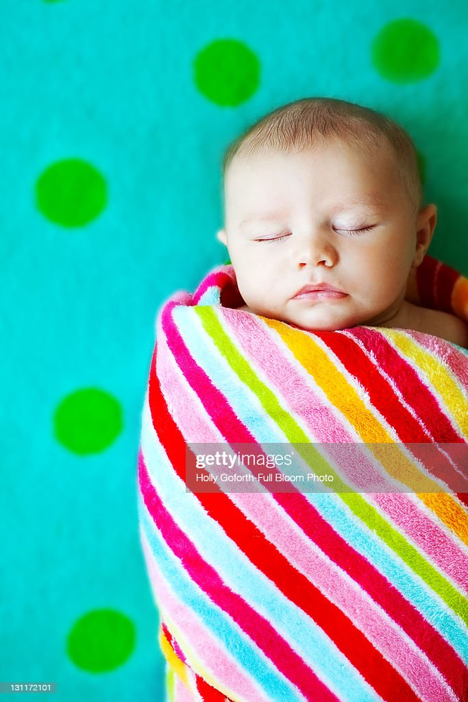 Baby wrapped in blanket : Stock Photo