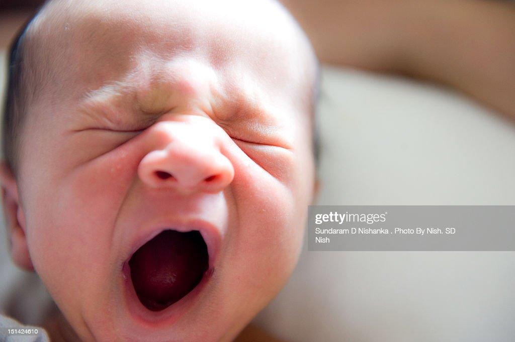 Baby yawning : Stock Photo