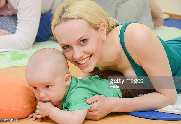 Baby Yoga indoor training with mother