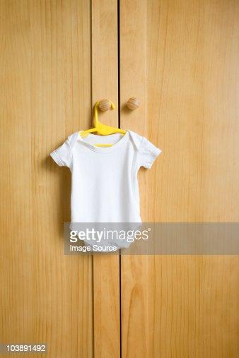 Babygro hanging on wardrobe