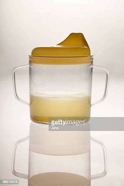 Baby's cup with dirty water