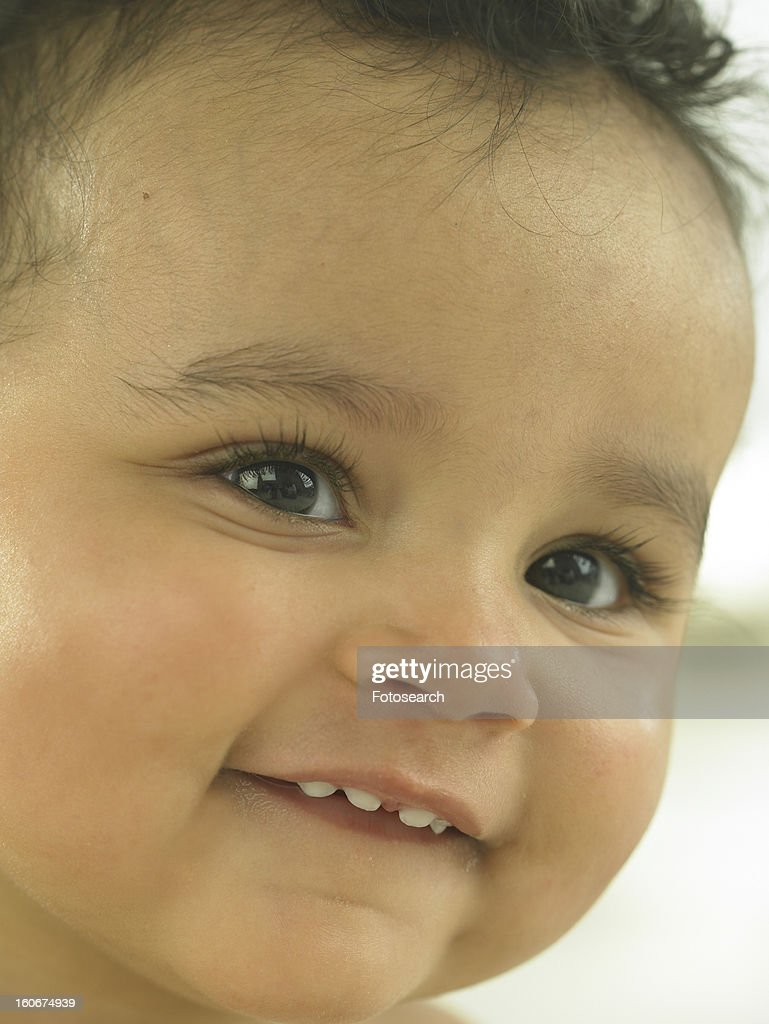 Baby's face close up : Stock Photo
