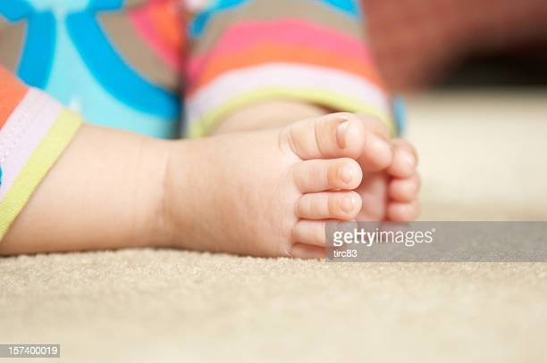 Baby's feet and toes on soft carpet