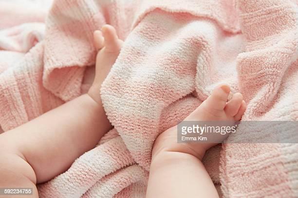 Babys legs in bed