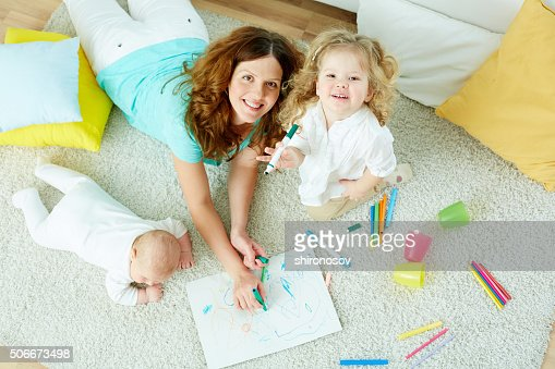 Babysitter with kids : Stock Photo
