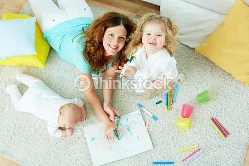 Babysitter with kids : Stock Photo