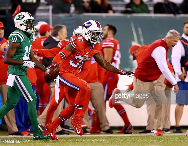Bacarri Rambo of the Buffalo Bills celebrates after he intercepted the ball in the final minute of the game as Kenbrell Thompkins of the New York...