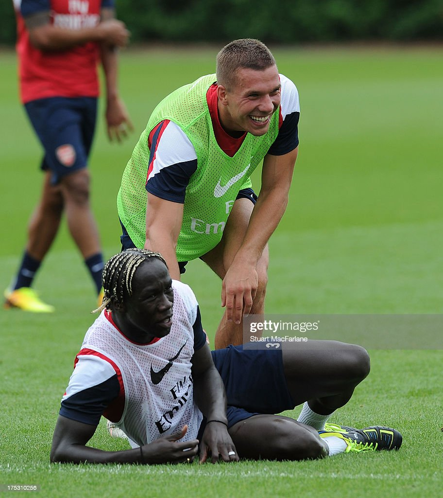 <a gi-track='captionPersonalityLinkClicked' href=/galleries/search?phrase=Bacary+Sagna&family=editorial&specificpeople=745680 ng-click='$event.stopPropagation()'>Bacary Sagna</a> and <a gi-track='captionPersonalityLinkClicked' href=/galleries/search?phrase=Lukas+Podolski&family=editorial&specificpeople=204460 ng-click='$event.stopPropagation()'>Lukas Podolski</a> of Arsenal joke around during a training session at London Colney on August 02, 2013 in St Albans, England.