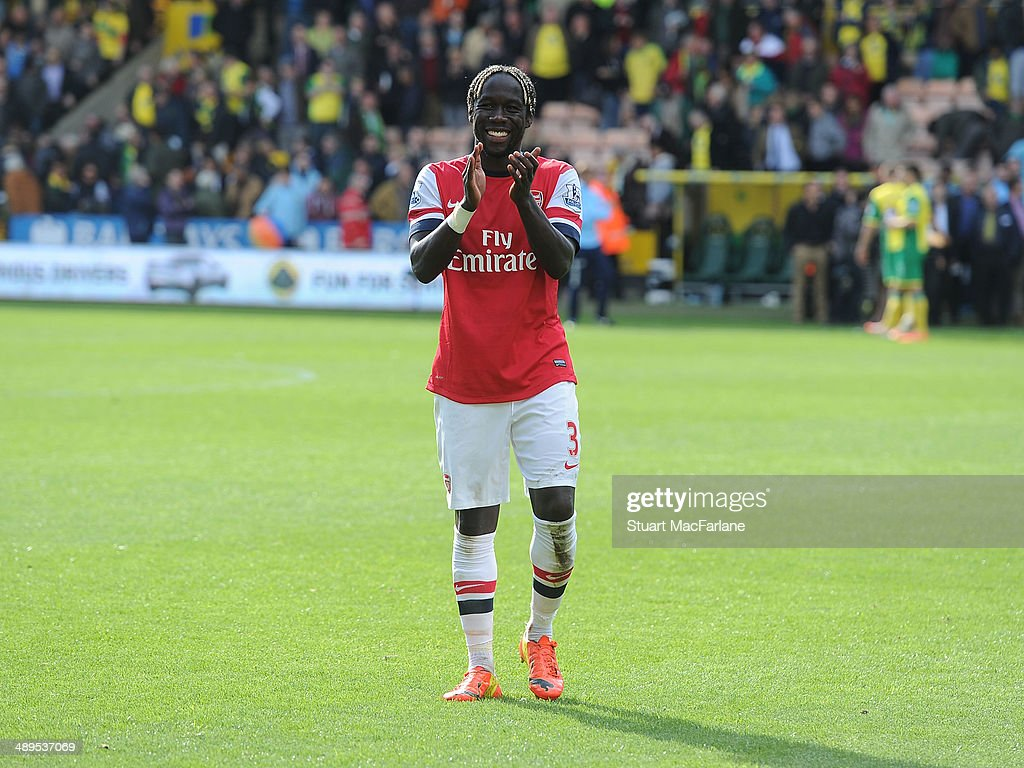 Bacary Sagna applauds the Arsenal fans after the Barclays Premier League match between Norwich City and Arsenal at Carrow Road on May 11, 2014 in Norwich, England.