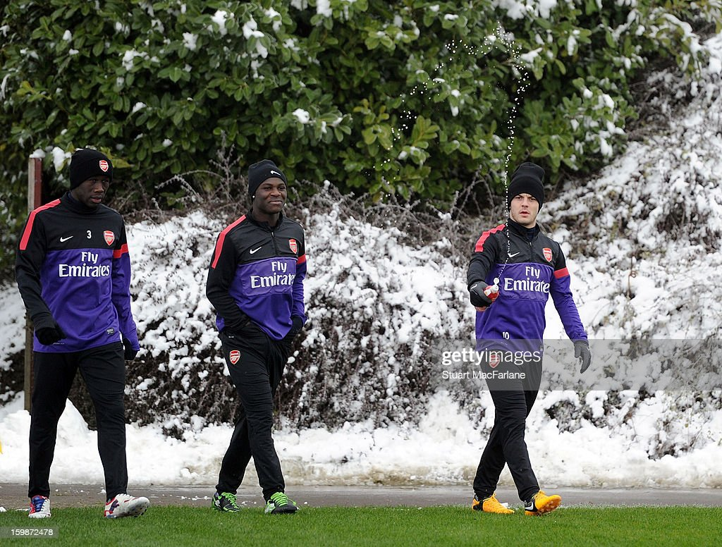 Bacary Sagna, Emmanuel Frimpong and Jack Wilshere of Arsenal arrive at a training session at London Colney on January 22, 2013 in St Albans, England.