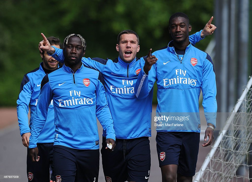 ST ALBANS - ENGLAND, MAY 3. (L-R) Bacary Sagna, <a gi-track='captionPersonalityLinkClicked' href=/galleries/search?phrase=Lukas+Podolski&family=editorial&specificpeople=204460 ng-click='$event.stopPropagation()'>Lukas Podolski</a> and <a gi-track='captionPersonalityLinkClicked' href=/galleries/search?phrase=Yaya+Sanogo&family=editorial&specificpeople=5862550 ng-click='$event.stopPropagation()'>Yaya Sanogo</a> of Arsenal before a training session at London Colney on May 3, 2014 in St Albans, England.
