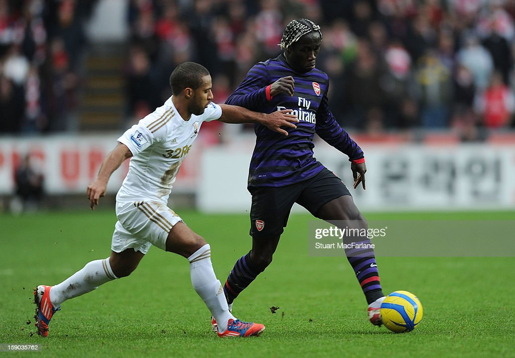 Bacary Sagna of Arsenal breaks past <a gi-track='captionPersonalityLinkClicked' href=/galleries/search?phrase=Wayne+Routledge&family=editorial&specificpeople=206672 ng-click='$event.stopPropagation()'>Wayne Routledge</a> of Swansea during the FA Cup Third Round match between Swansea City and Arsenal at the Liberty Stadium on January 6, 2013 in Swansea, Wales.