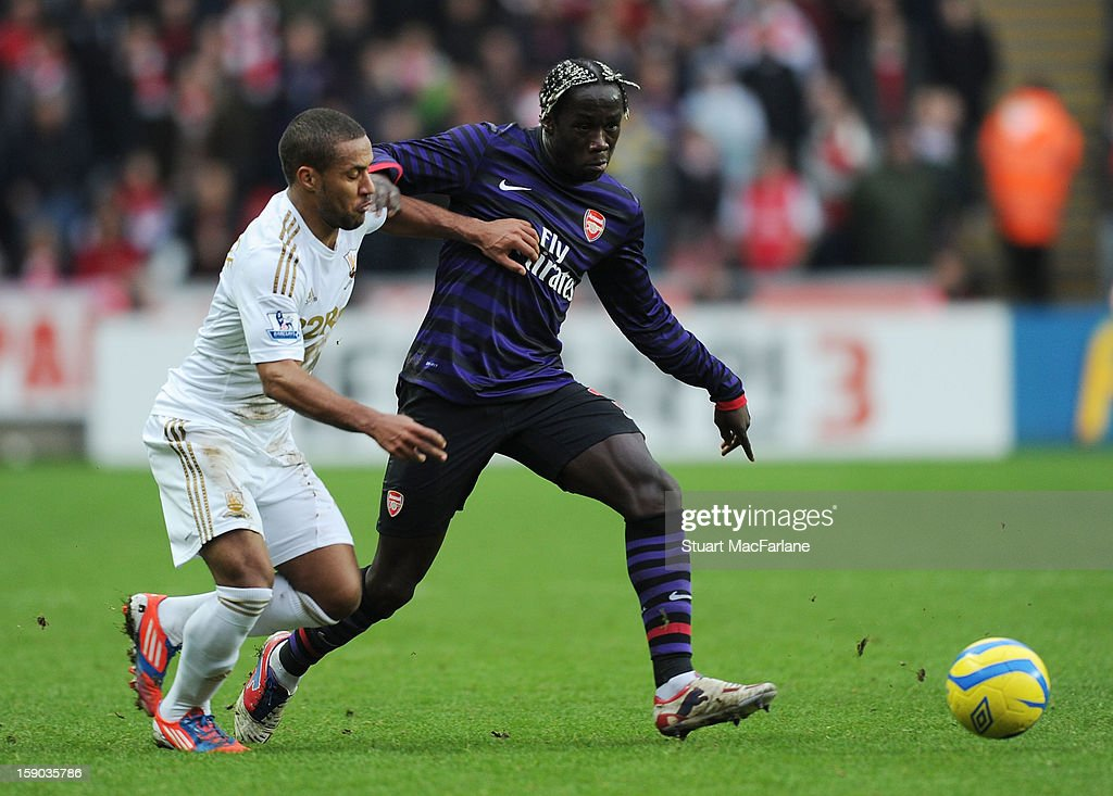 Bacary Sagna of Arsenal breaks <a gi-track='captionPersonalityLinkClicked' href=/galleries/search?phrase=Wayne+Routledge&family=editorial&specificpeople=206672 ng-click='$event.stopPropagation()'>Wayne Routledge</a> of Swansea during the FA Cup Third Round match between Swansea City and Arsenal at the Liberty Stadium on January 6, 2013 in Swansea, Wales.