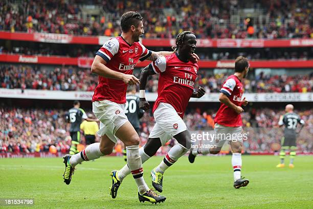 Bacary Sagna of Arsenal celebrates with Olivier Giroud as he scores their third goal during the Barclays Premier League match between Arsenal and...