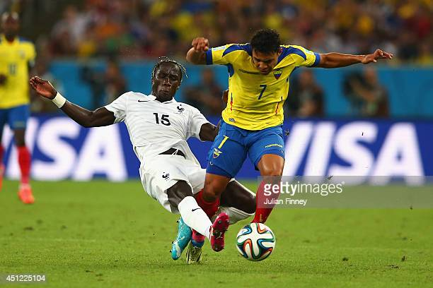 Bacary Sagna of France tackles Jefferson Montero of Ecuador during the 2014 FIFA World Cup Brazil Group E match between Ecuador and France at...
