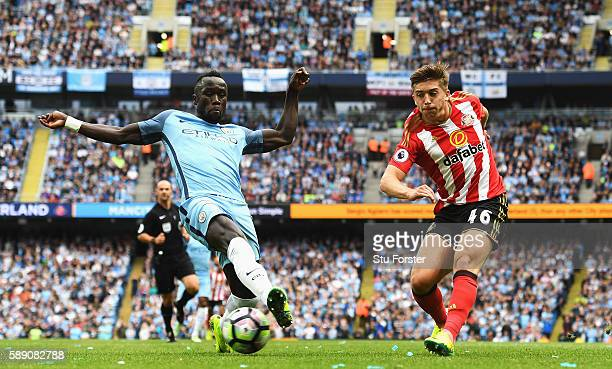 Bacary Sagna of Manchester City attempts to black Lynden Gooch of Sunderland shot during the Premier League match between Manchester City and...