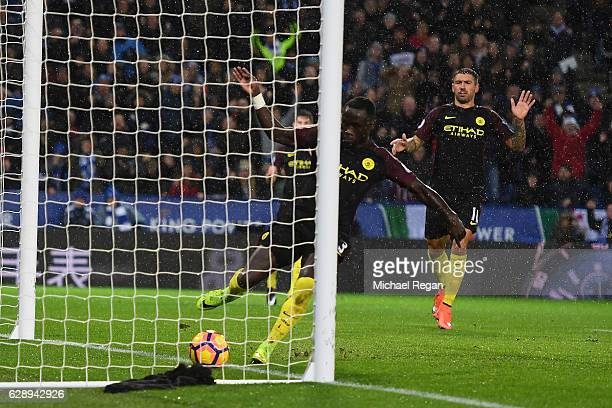 Bacary Sagna of Manchester City attempts to stop the ball as Jamie Vardy of Leicester City scores his sides fourth goal during the Premier League...