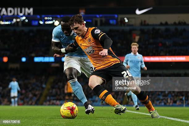 Bacary Sagna of Manchester City in action with Andrew Robertson of Hull City during the Capital One Cup Quarter Final match between Manchester City...