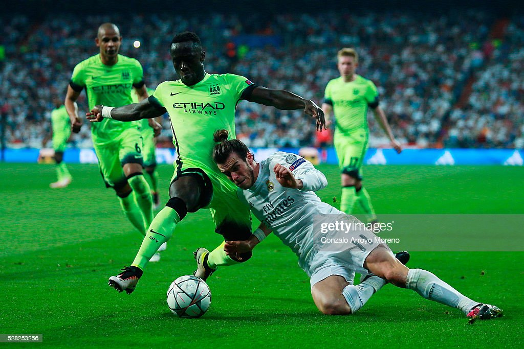 Bacary Sagna of Manchester City makes a tackle on Gareth Bale of Real Madrid during the UEFA Champions League semi final, second leg match between Real Madrid and Manchester City FC at Estadio Santiago Bernabeu on May 4, 2016 in Madrid, Spain.