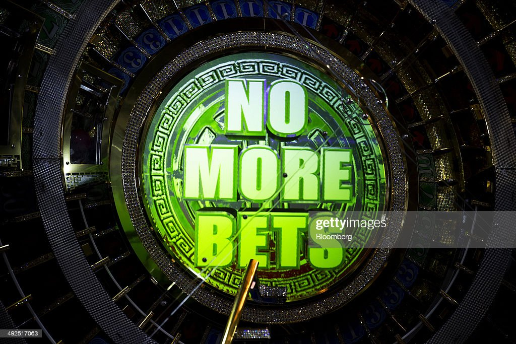 A baccarat machine reads 'No More Bets' at an International Game Technology (IGT) booth at the Global Gaming Expo (G2E) inside the Venetian Macao resort and casino, operated by Sands China Ltd., a unit of Las Vegas Sands Corp., in Macau, China, on Tuesday, May 20, 2014. The gaming expo runs through May 22. Photographer: Brent Lewin/Bloomberg via Getty Images