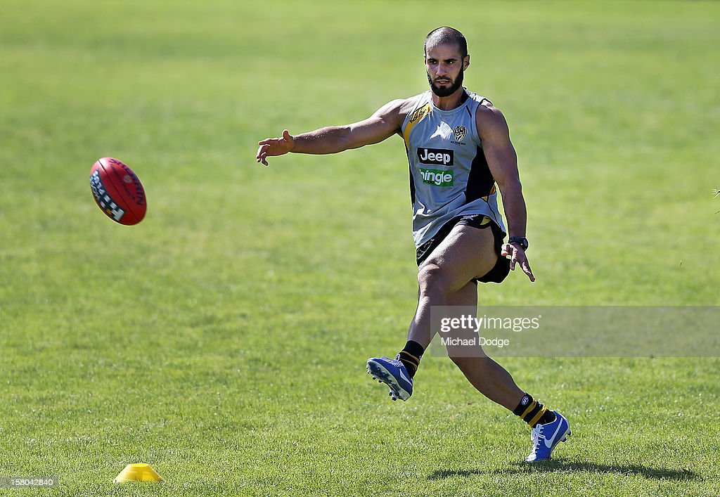 Bachar Houli kicks the ball during a Richmond Tigers AFL training session at Trevor Barker Beach Oval on December 10, 2012 in Melbourne, Australia.