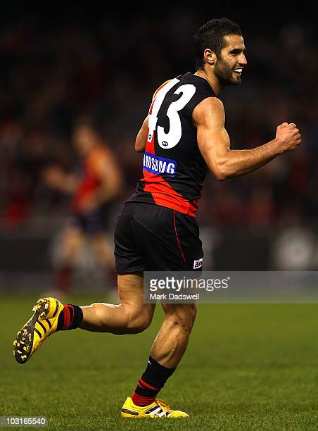Bachar Houli of the Bombers celebrates a goal during the round 18 AFL match between the Essendon Bombers and St Kilda Saints at Etihad Stadium on...