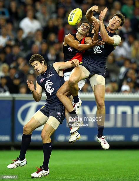 Bachar Houli of the Bombers is caught between Jordan Russell and Michael Jamison of the Blues during the round three AFL match between the Carlton...