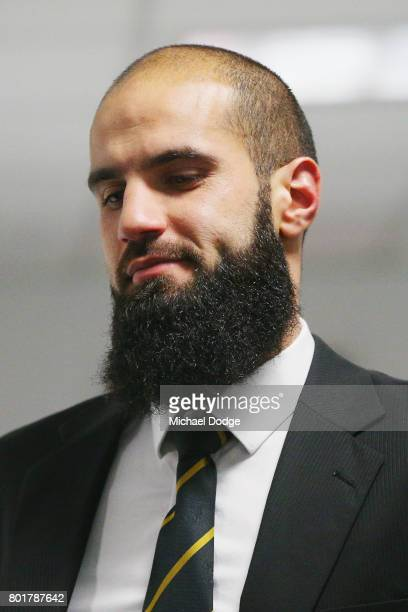 Bachar Houli of the Richmond Tigers enters a hearing room at the AFL tribunal on June 27 2017 in Melbourne Australia